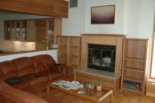 Dining and living room cabinets and fireplace surround