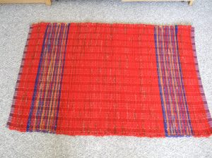 bright red wool blanket and accent stripes