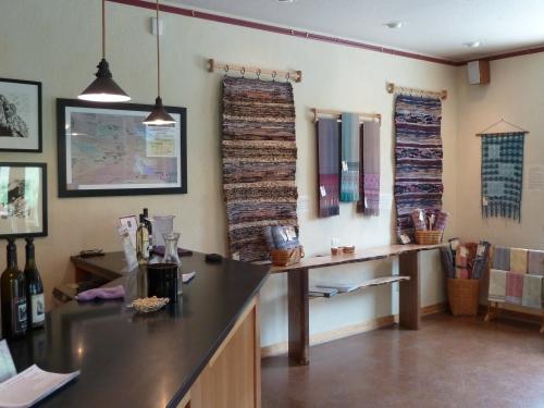 main wall to right of tasting bar