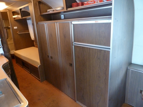 refrigerator and storage across from the galley