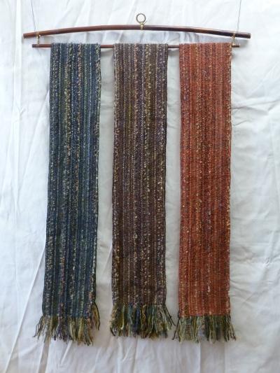 L to R: dark slate blue organic wool, brown wool boucle, orange rayon chenille
