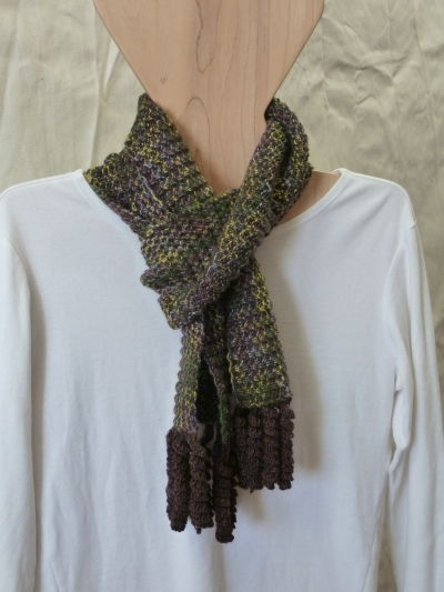 fluted fabric scarf with corkscrew tassles