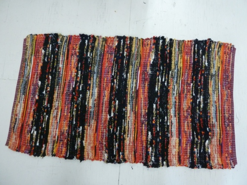 R190 - bands of black & color fringe alternated with bands of wooly worms in a color progression